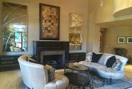 art deco living room furniture. art deco living room with cement fireplace high ceiling carpet pendant light furniture