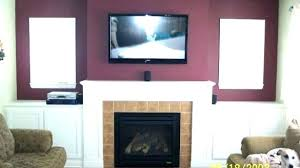 hanging television over fireplace hang above fireplace awesome best over fireplace ideas on above fireplace for hanging television
