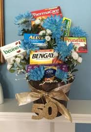 old age remes tucked into a flower arrangement is a forting idea for a 50 birthday see more 50th birthday gifts and party ideas at