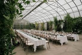 modern and simple wedding decor in the greenhouse at saskatoon farm white greenery