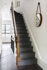 black painted stairs painted stairway and wood brown banisters plus staircase wall painting with white wall also