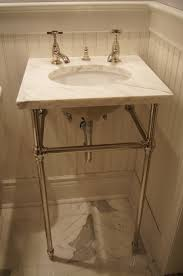 undermount sink with a marble top on console legs remodeled