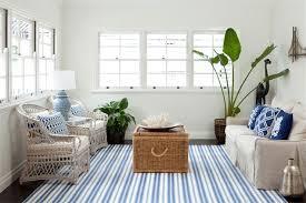inspiring living room design using blue striped rug by dash and albert rugs plus pretty sofa