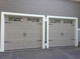 17 best ideas about garage door decorative hardware haas model 2060 steel carriage house style garage doors in sandstone 6 pane glass