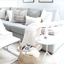light gray couch cream rug and blankets for living room on grey sofa