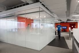office glass wall. kayak startup tech office meeting cube with graduated glass frosting and orange feature wall e