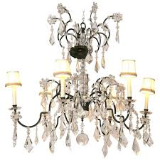large holly hunt wrought iron and crystal scroll form chandelier