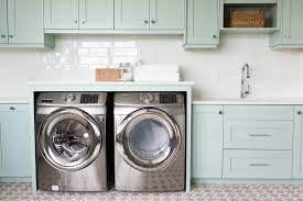 laundry room sink next to washer and dryer