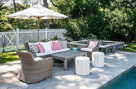 wicker patio sofa and chairs next to