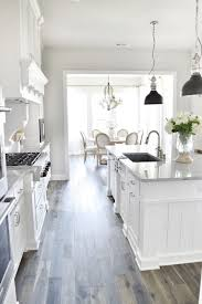 gray walls and white kitchen cabinets
