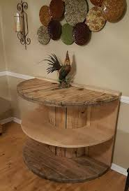 This beautiful spool table was made by Robin Owen's hubby! She said they  started off by cutting it in half and adding boards to the back to steady  it.
