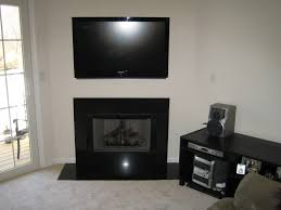 corner wall mount tv stand over fireplace added black stained wooden a cabinet with