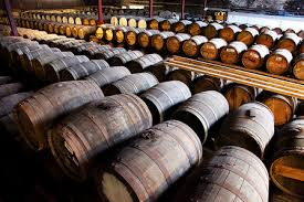 stacked oak barrels maturing red wine. Stacked Oak Barrels Maturing Red Wine