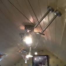 parallel wire lighting track with adjule spots can be sighted on various angles on ceiling