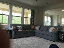 see a lot of blue too i was thinking adding navy tufted ottoman we need to blue gray couch