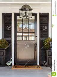 black front door to a family home with porch