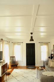 Ceiling treatment to hide old swirled plaster or popcorn ceiling.  www.remodlista.com