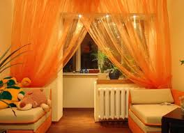 contemporary kids room with burnt orange sheer curtains and brown