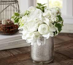 faux white flower arrangement in mercury glass vase