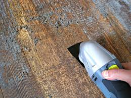 remove tile adhesive from wood floor