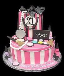 most s love mac make up this cake celebrates that love the cake has pin and white candy stripes and is surrounded by eye shadow pallets blushers