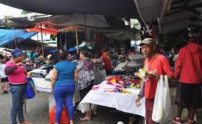 Resultado de imagen para fotos de haitianos en la calle Espana de Santiago