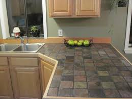 slate tile kitchen countertops. It could totally happen. I love the  richness and variegated