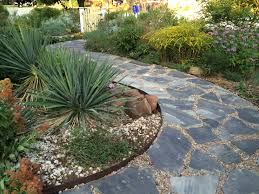 Front yard path, using Blue Stigler flagstone and river rock infill.