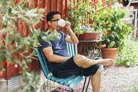Wybierz z szerokiej gamy podobnych scen. Man Drinking A Coffee Outside In Mortfors Sweden Stock Photo Dissolve