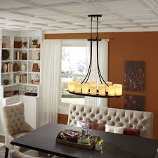 dining room kitchen with mini pendants and recessed lighting