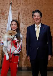 russian figure skating gold medallist alina zagitova and anese prime minister shinzo abe with the puppy