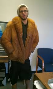 i have a red fox fur coat with mr j embroderied on the inside would this be made by mr john how can i find out the value of it