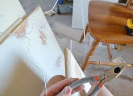 this quick makes painting cabinet doors so much quicker just grab a metal hanger
