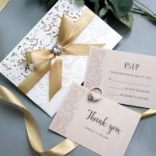 Elegant Ivory Laser Cut Wedding Invitations With Gold Shimmer Ribbon And Diamante White And Blush Spring Wedding Colors Cheap Invitations Ws002