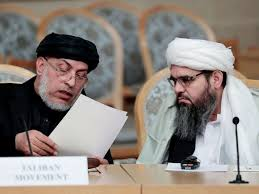 photo unidentified representatives of the afghan taliban movement speak prior to the start of the