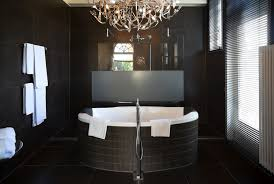 stylish bathroom lighting. delighful stylish this bathroom gets a big dose of glamour from an ohsochic contemporary  chandelier installed above luxurious tub if you love this look need to make  throughout stylish bathroom lighting n