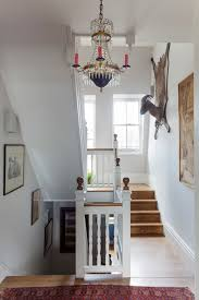 stair banister staircase traditional with beaded chandelier high ceiling red candles stair