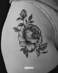 фото татуировки пион в стиле ориентал татуировки на бедре