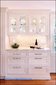 such a cute idea log cabin kitchen white cabinetry marble countertops backsplash glass cabinets kitchen windows