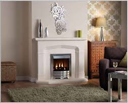 small living room design with silver aluminum framed electric fireplace with white ivory mantel and