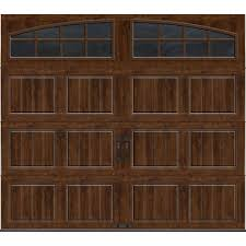 clopay gallery collection 8 ft x 7 ft 18 4 r value intellicore insulated ultra grain walnut garage door with arch window gr2su wo grla1 the home depot