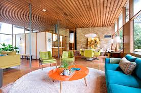 fabulous midcentury modern living room with original brick walls and flooring from 1950s design