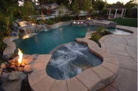 inground pools with waterfalls and hot tubs. Tropical Inground Pool With A Hot Tub And Waterfall Pools Waterfalls Tubs G