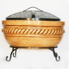 clay fire pit with iron stand
