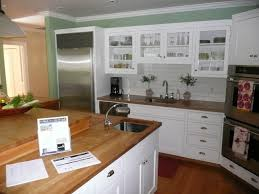 small kitchen spaces with white wooden cabinet and island maple
