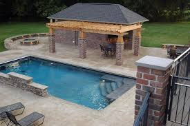 Interesting Wooden Pergola Roofing With Stones Exterior Columns Also Grey  Pavers Backsyard Around Rectangular Pool As Natural Landscape Backyard Ideas