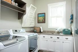wall mounted cabinets for laundry room clothes rack farmhouse with built in cabinetry image by court wall mounted cabinets for laundry