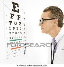 Doctor Reading Eye Chart Stock Image K1499502 Fotosearch