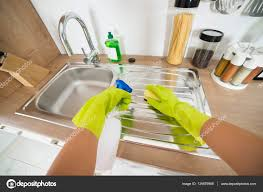 Woman Cleaning Kitchen Sink Stock Photo Andreypopov 139879998