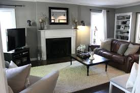 elegant grey color ideas for living room with brick fireplace and brown furniture brown leather sofa